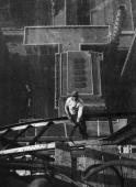 Highangle view of a worker sitting on a steel girder high atop the Chrysler Building on the 54th floor during its construction New York City