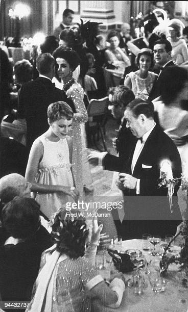 Highangle view of American actress Mia Farrow and lawyer and White House Special Advisor Ted Sorenson as they attend Truman Capote's Black and White...