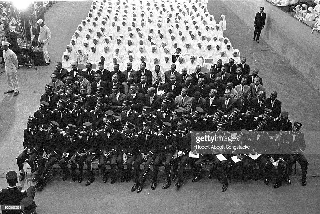 High-angle view of Nation of Islam attendees of the Saviour's Day celebrations at International Ampitheatre, Chicago, Illinois, February 27, 1966. The uniformed men in the fore wear the uniform of the Fruit of Islam, a subset of the Nation of Islam.