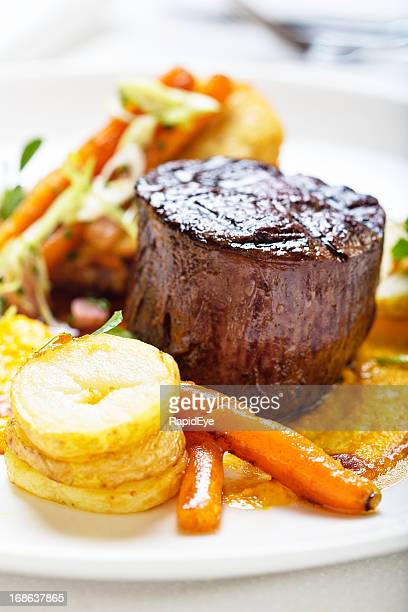 High-angle view of restaurant style steak and vegetables