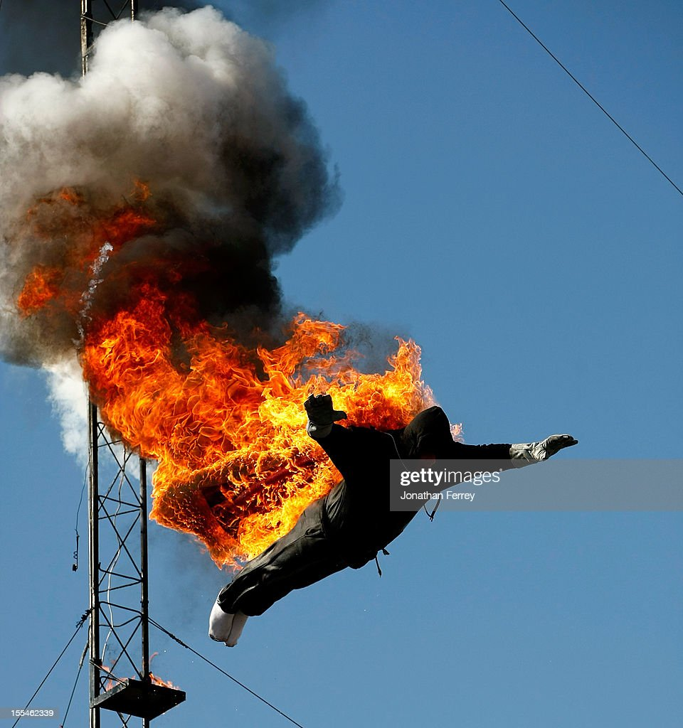 A higher diver performs while lit on fire at the No Limits Garage Party Presented By WinStar at Texas Motor Speedway on November 4, 2012 in Fort Worth, Texas.