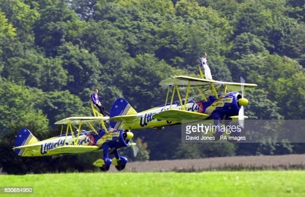 Highflying couple Caroline Hackwood and Justin Bunn taking off before their airborne wedding ceremony strapped to the wings of 1940s biplanes The...
