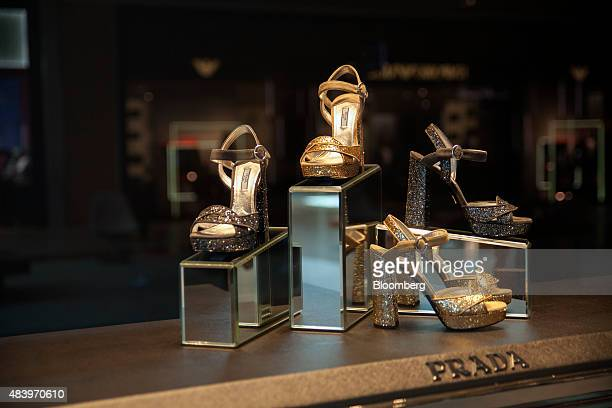 Highheeled shoes sit on display in the window of a Prada SpA store at the Village Mall in Rio de Janeiro Brazil on Wednesday Aug 12 2015 Cartier and...