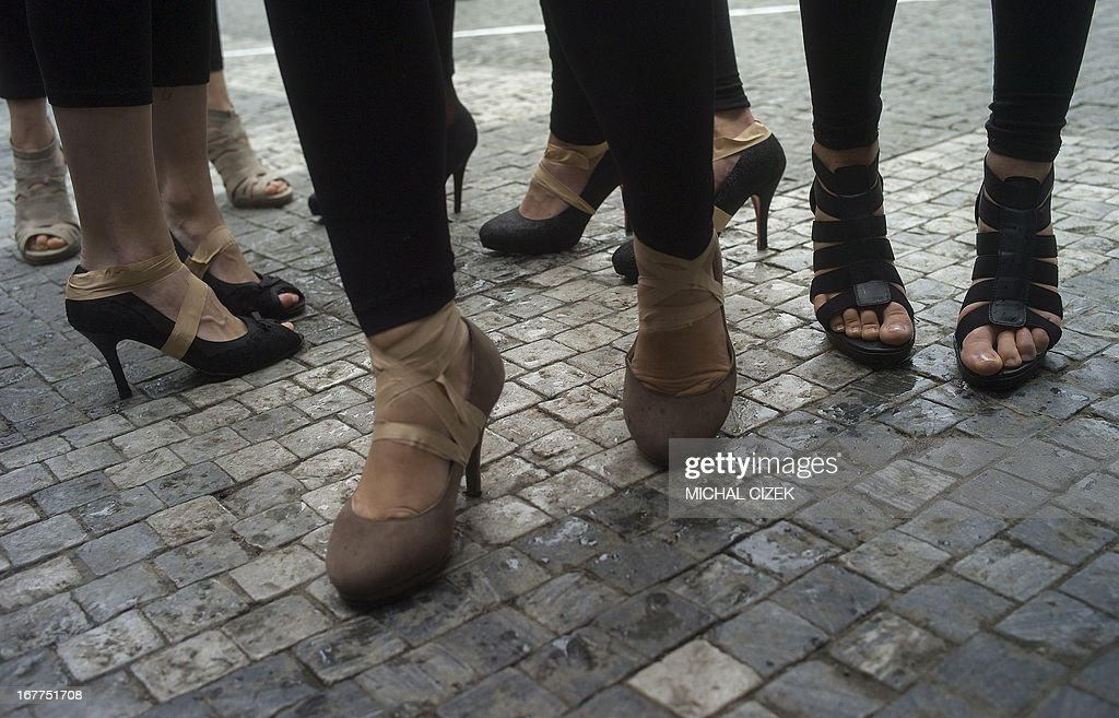 High-heels are taped onto feet of candidates prior to the start of the ''High-heel run' competition in Prague, Czech Republic, on April 29, 2013