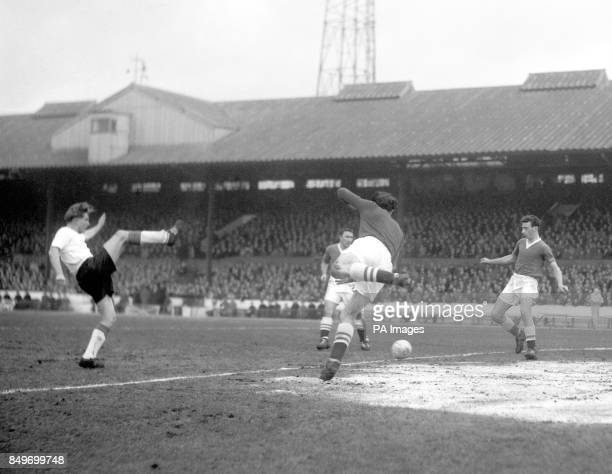 Highkicking Dave Hickson Everton's centreforward playing his last match before his suspension takes effect lashes the ball towards the Chelsea goal...