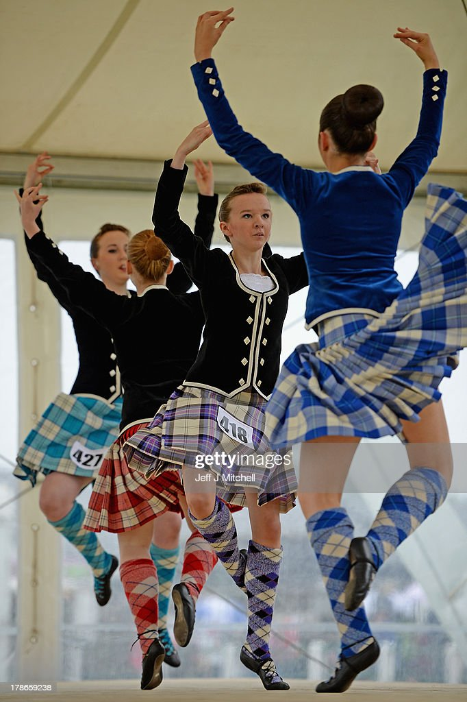 Highland dancers perform the Real of Tulloch during competition at the Cowal Highland Gathering on August 30, 2013 in Dunnon, Scotland. First held in 1894, the Cowal Games are held over three days and are one of the largest in the world attracting competitors from Canada, USA, South Africa, Australia and New Zealand.