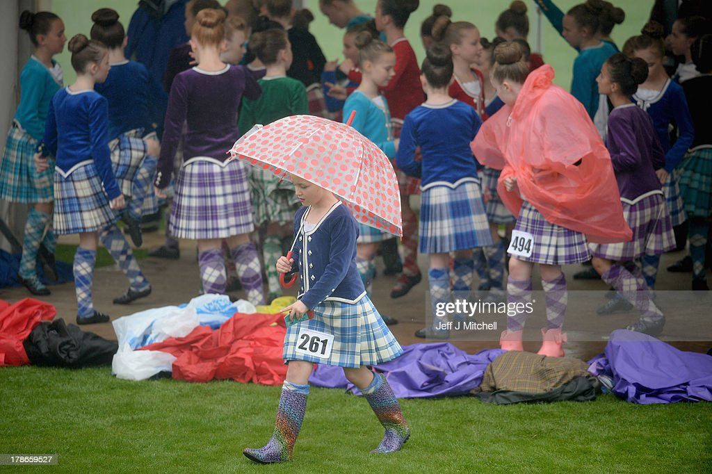Highland dancers, shelter from the rain before competing at Cowal Highland Gathering on August 30, 2013 in Dunoon, Scotland. First held in 1894, the Cowal Games are held over three days and are one of the largest in the world attracting competitors from Canada, USA, South Africa, Australia and New Zealand.