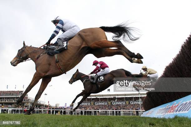 Highland Lodge ridden by Mr B O'Neill Tofino Bay ridden by Nina Carberry and eventual winner Back In Focus ridden by Patrick Mullins jump a fence in...