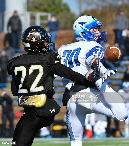 Highland Springs' Eddie Davis Jr breaks up a pass intended for Tuscarora's Adam Thorne during the second quarter in the Virginia Class 5 state...