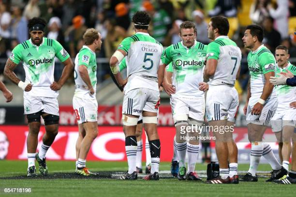 Highlanders playes show their disappointment after a Hurricanes try during the round four Super Rugby match between the Hurricanes and the...