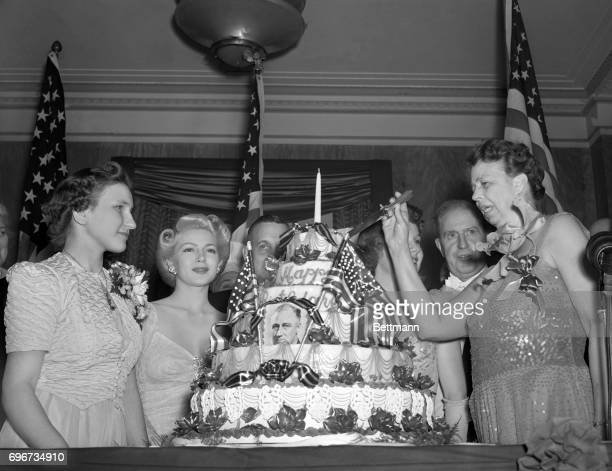 Highlights of the President's birthday celebration in Washington was cutting of the giant cake by Mrs Franklin D Roosevelt Left to right Anna...