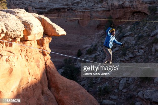 A highliner walks across a long slackline, Moab, Utah.