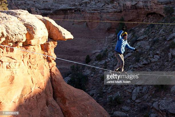 A highliner walks across a long slackline, Moab, Utah.