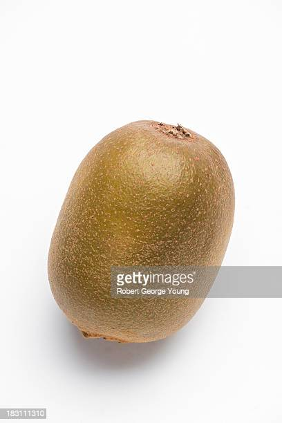 Highly detailed close-up of a golden kiwi fruit