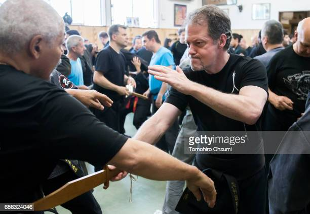 A highranked disciple of Grandmaster Masaaki Hatsumi right uses a wooden mock knive as he takes part in a lesson at the Bujinkan dojo on May 21 2017...