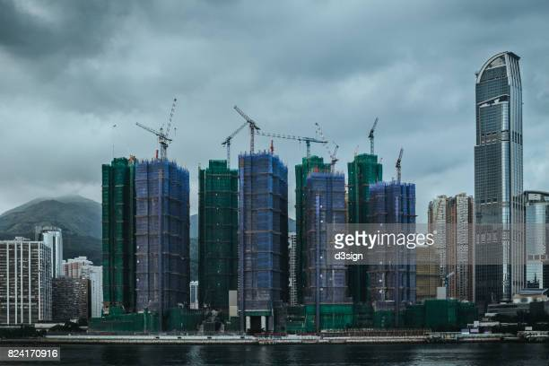 Highrise and compact residential buildings under construction by the   waterfront
