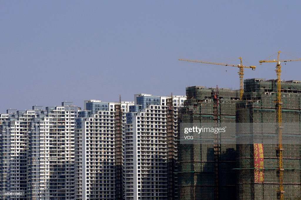 Highrise buildings are seen on November 2 2014 in Suzhou China
