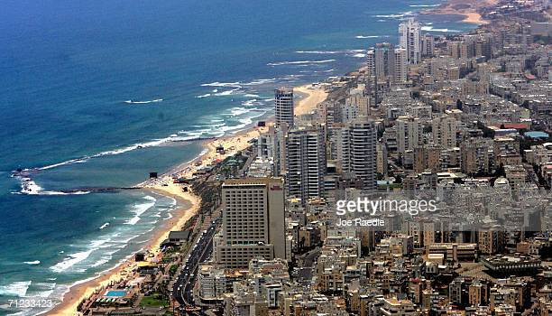 Highrise hotels and apartment buildings crowd the Mediterranean coastline May 29 2006 at Bat Yam an Israeli suburban city south of Tel Aviv Prime...