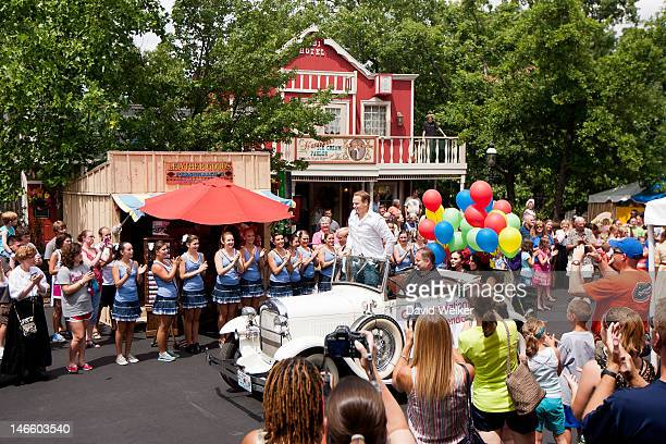 Highrope walker Nik Wallenda enters in a Ford Model A during the homecoming parade on the Silver Dollar City Square on June 20 2012 in Branson...