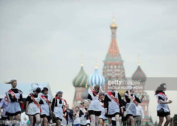 Highschool graduates celebrate the last day of their classes on Red Square in Moscow on May 25 2011 Russian teenagers celebrated the end of their...