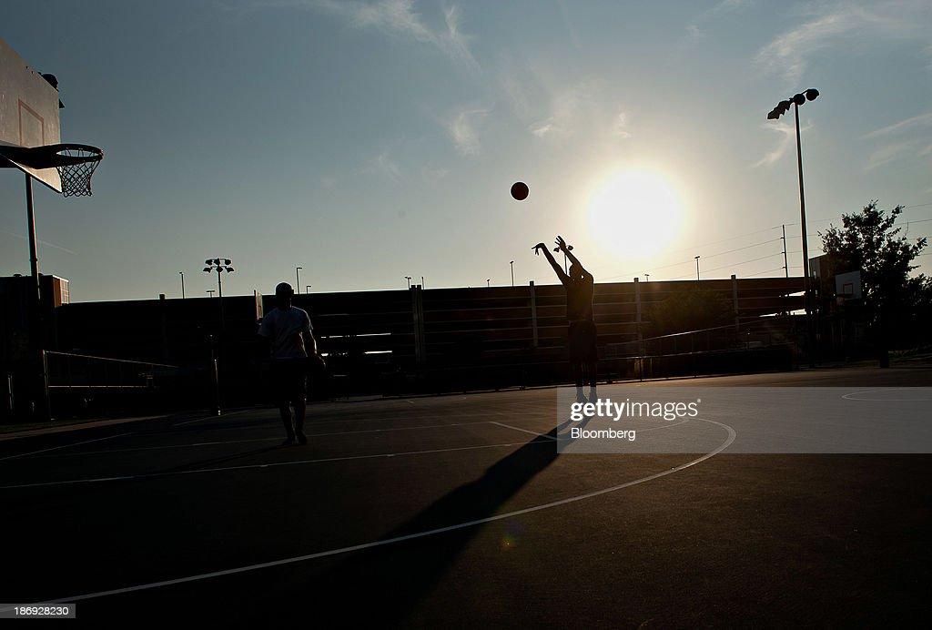 Highschool junior Edward Morrow shoots a basket on an outdoor court at the University of Nebraska in Lincoln Nebraska US on Thursday July 4 2013...