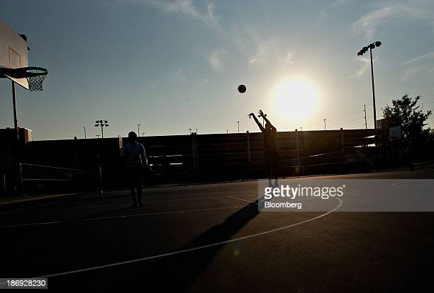 Highschool junior Edward Morrow shoots a basket on an outdoor court at the University of Nebraska in Lincoln Nebraska US on Thursday July 4 2013...