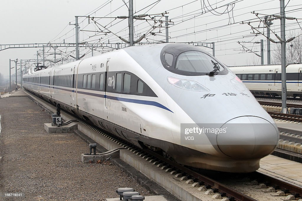 A CRH high-speed train arrives at Xuchang East Railway Station on December 26, 2012 in Xuchang, China. The world's longest high-speed rail route linking Beijing and Guangzhou started operation on Wednesday. Running at an average speed of 300 kilometers per hour, the 2,298-kilometer new route will cut the travel time between Beijing and Guangzhou from more than 20 hours to around eight.