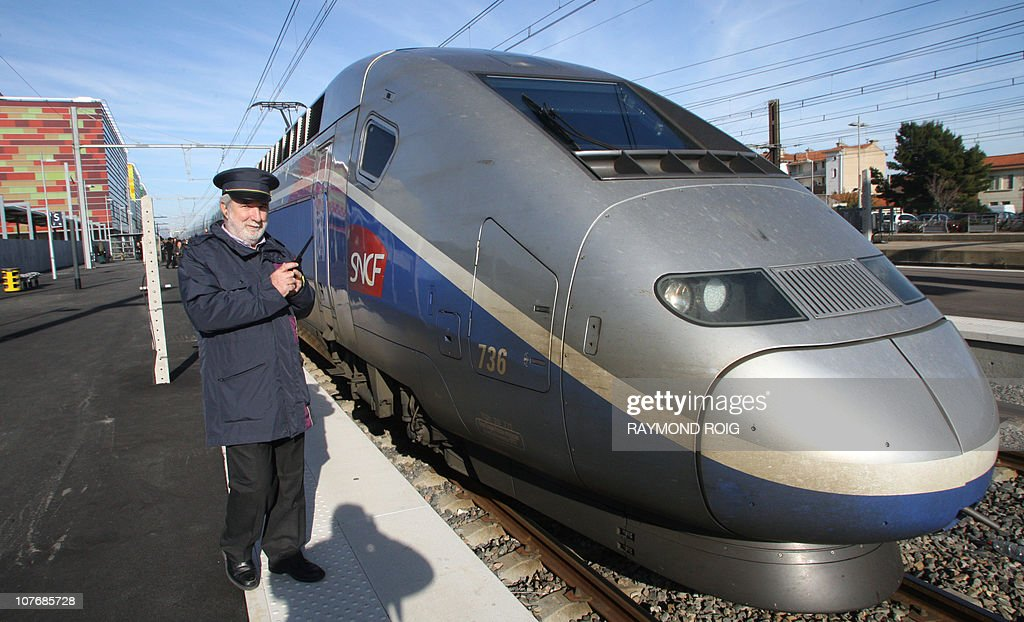 A highspeed train enters in the Perpignan's railway station on December 19 2010 for its first trip between Perpignan and Figueras AFP PHOTO / RAYMOND...