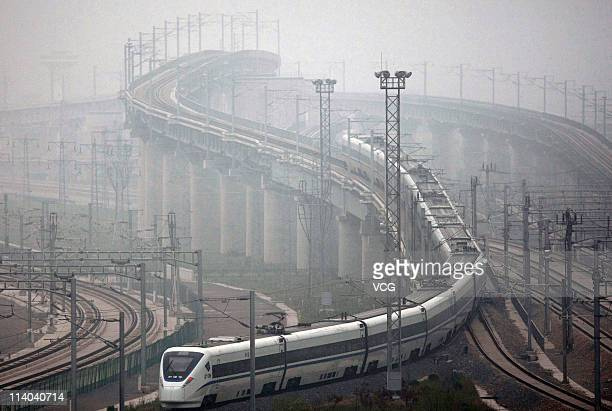 A CRH highspeed train leaves Shanghai Hongqiao Railway Station during its test run on May 11 2011 in Shanghai China After 3 years construction from...
