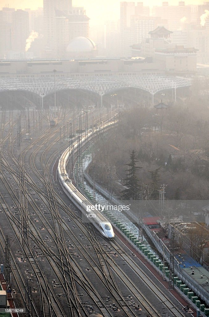 A CRH high-speed train leaves the Beijing West Railway Station on December 26, 2012 in Beijing, China. The world's longest high-speed rail route linking Beijing and Guangzhou started operation on Wednesday. Running at an average speed of 300 kilometers per hour, the 2,298-kilometer new route will cut the travel time between Beijing and Guangzhou from more than 20 hours to around eight.