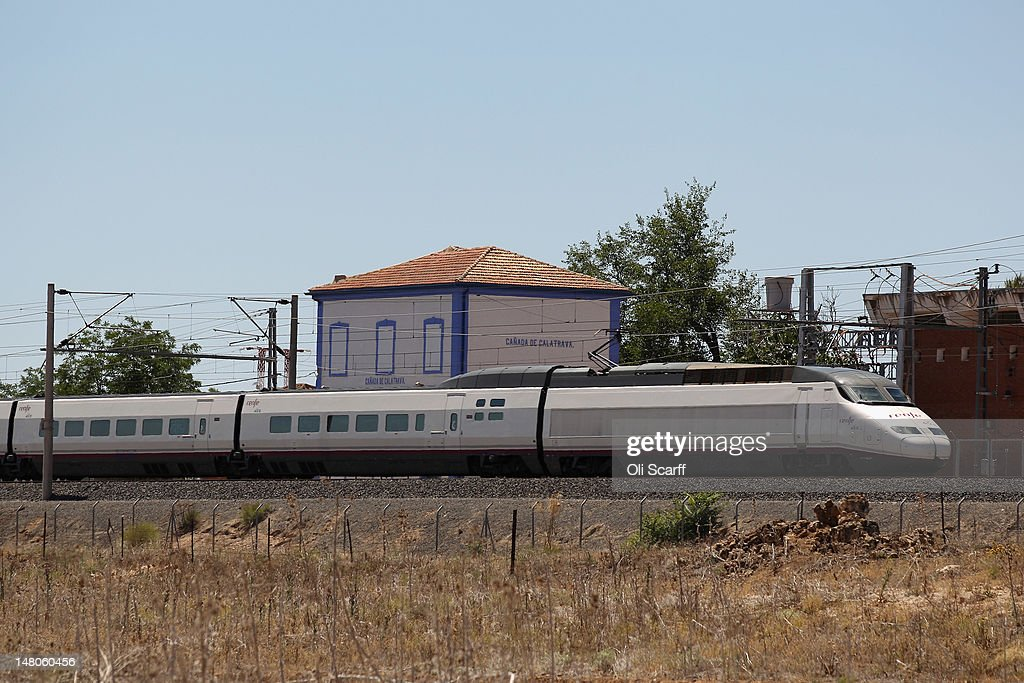 A high-speed train passes in front of Cuidad Real International Airport which stands dormant after closing in April 2012, when all scheduled flights ceased to operate to or from it, on July 6, 2012 in Ciudad Real, Spain. The large international airport, which was completed in 2009 at a cost of 1.1 billion euros, was intended to serve both Madrid and the Andalucían coast, accessible in 50 minutes via a high speed rail link, however lack of demand driven by Spain's economic crisis has seen closure after just three years. Despite having the fourth largest economy in the Eurozone, the economic situation in Spain remains troubled with their unemployment rate the highest of any Eurozone country. Spain is currently administering billions of euros of spending cuts and tax increases in a bid to manage its national debt. Spain also has access to loans of up to 100 billion euros from the European Financial Stability Facility which will be used to rescue the country's banks that have been badly affected by a crash in property prices.