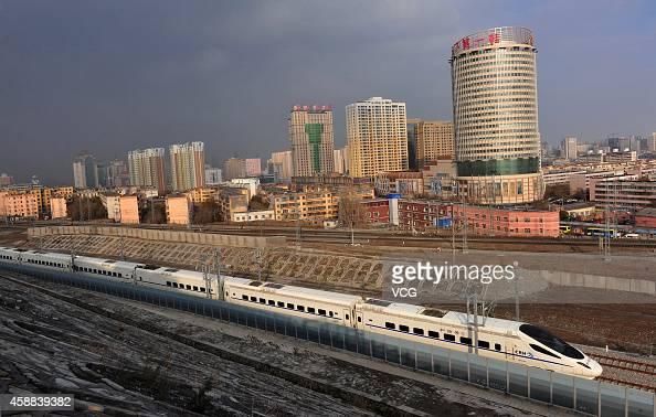 A CRH highspeed train runs across Urumqi city during its test run on November 11 2014 in Urumqi Xinjiang Uyghur Autonomous Region of China The...