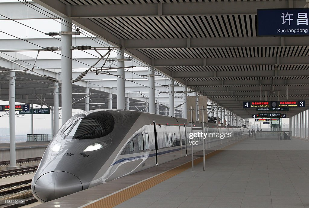 A CRH high-speed train stops at Xuchang East Railway Station on December 26, 2012 in Xuchang, China. The world's longest high-speed rail route linking Beijing and Guangzhou started operation on Wednesday. Running at an average speed of 300 kilometers per hour, the 2,298-kilometer new route will cut the travel time between Beijing and Guangzhou from more than 20 hours to around eight.