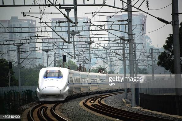 A highspeed train travels on the railway to Beijing in Nanning southern China's Guangxi province on June 13 2014 Growth in China's industrial output...