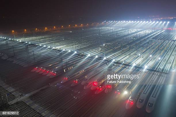 Highspeed trains at a maintenance station wait to set out on the first day of the 40day Spring Festival Travel Peak on January 13 2017 in Wuhan China...