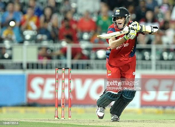 Highveld Lions batsman Chris Morris plays a shot on October 28 2012 during the final Champions League T20 match against the Sydney Sixers at the...