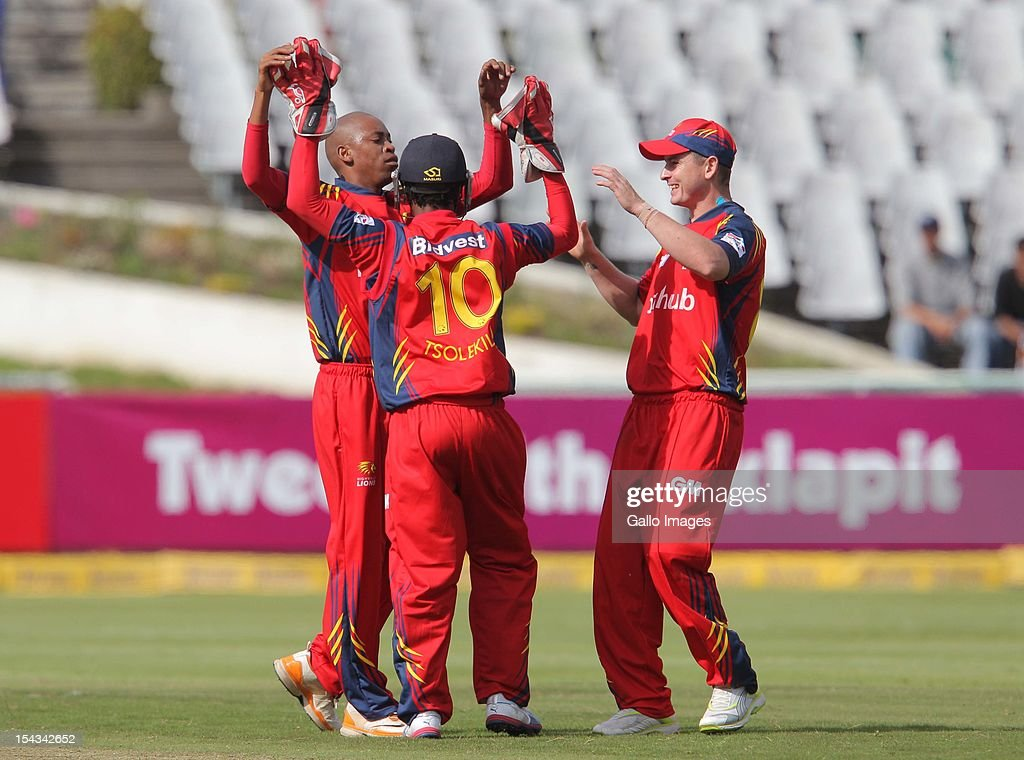 Highveld Lions players celebrate during the Karbonn Smart CLT20 match between bizbub Highveld Lions (South Africa) and Sydney Sixers (Australia) at Sahara Park Newlands on October 18, 2012 in Cape Town, South Africa.