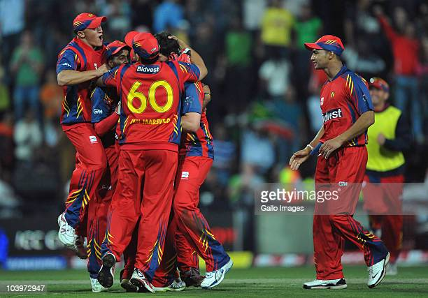 Highveld Lions players celebrate their win of the Airtel Champions League Twenty20 match between Mumbai Indians and Highveld Lions at Wanderers...