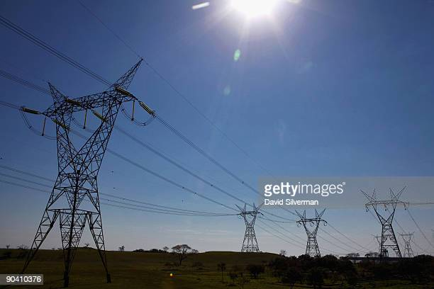 Highvoltage power lines carry electricity from the Itaipu Dam hydroelectric plant which sits on the Iguazu River a short distance downstream from the...