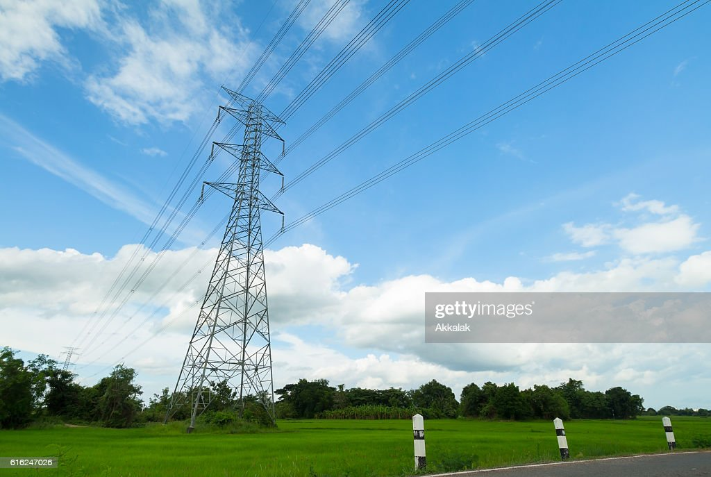 high-voltage tower in a rice field : Stock Photo