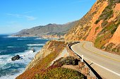 Highway 1 running along Pacific coast in Big Sur state parks in California.