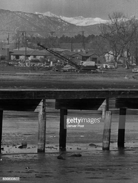 Highway 70 Berkeley Lake was drained to accommodate the freeway project Posts of the fishing pier were exposed when the water receded Many Denverites...