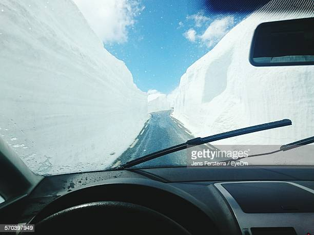 Highway Amidst Ice Seen From Car Windshield