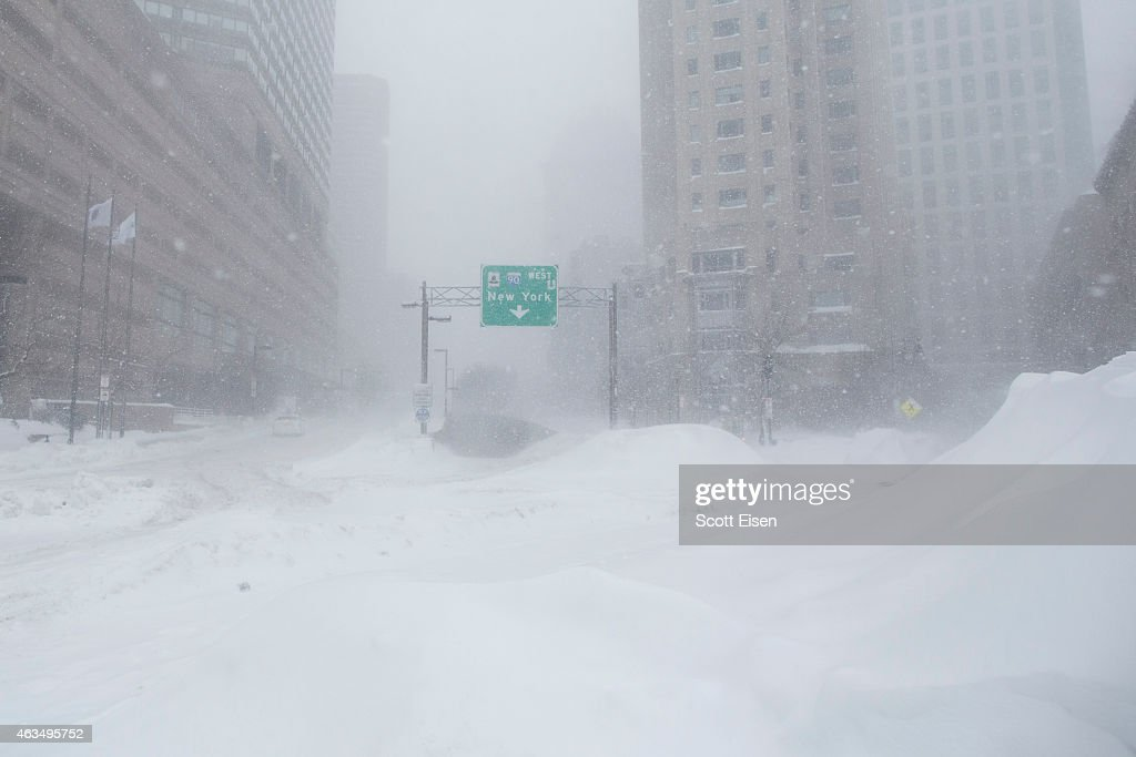 A highway entrance is blurred by snow during winter storm Neptune which dropped over a foot of snow February 15 2015 in Boston Massachusetts This is...