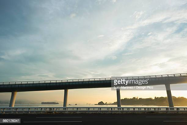 Highway from Xiamen city, China at sunset, with Gulangyu island in the background