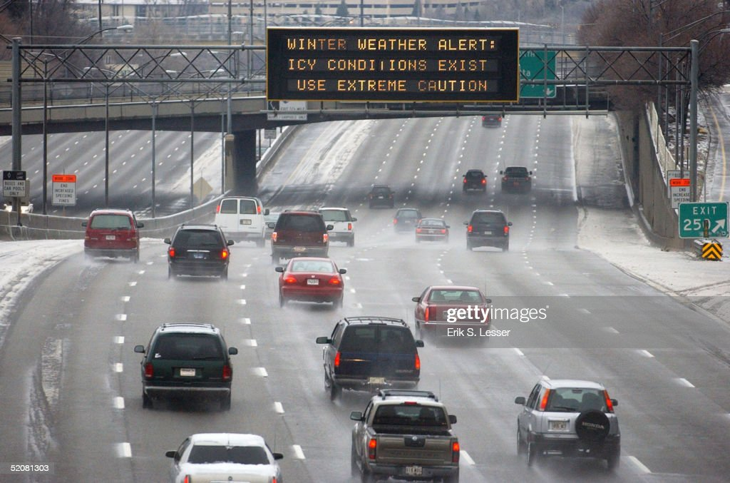 A highway informational sign advises motorists to the dangerous driving conditions along Interstate 7585 January 29 2005 in downtown Atlanta Georgia...
