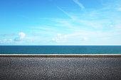Highway on sunny summer daynear the water