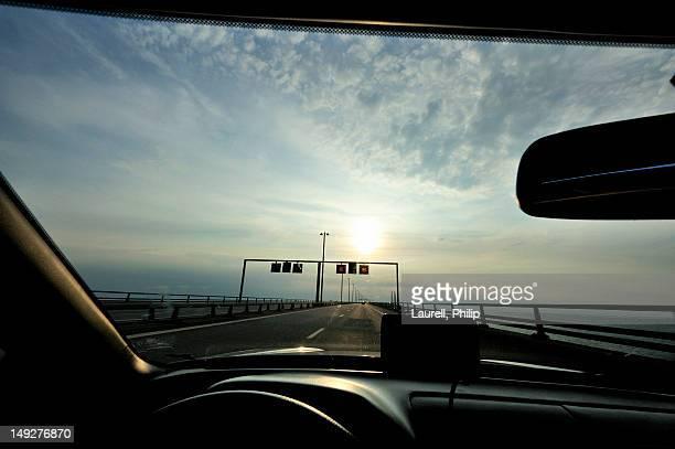 Highway seen through car windshield