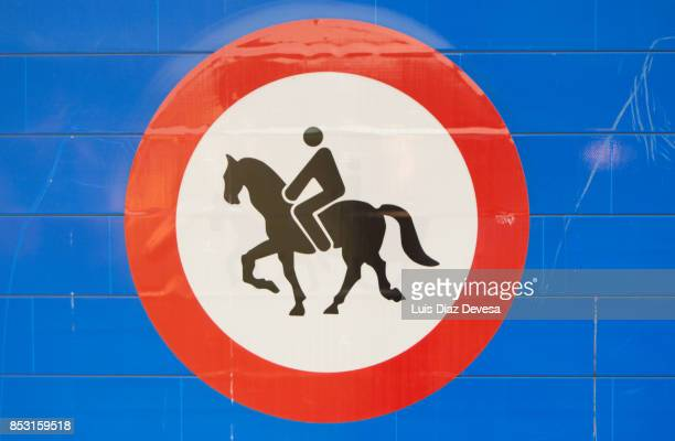 Highway signs prohibiting horses