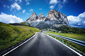 Highway through Dolomites valley. Northern italy.